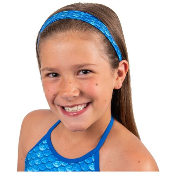a young girl is modeling a blue mermaid scale headband and matching tankini top