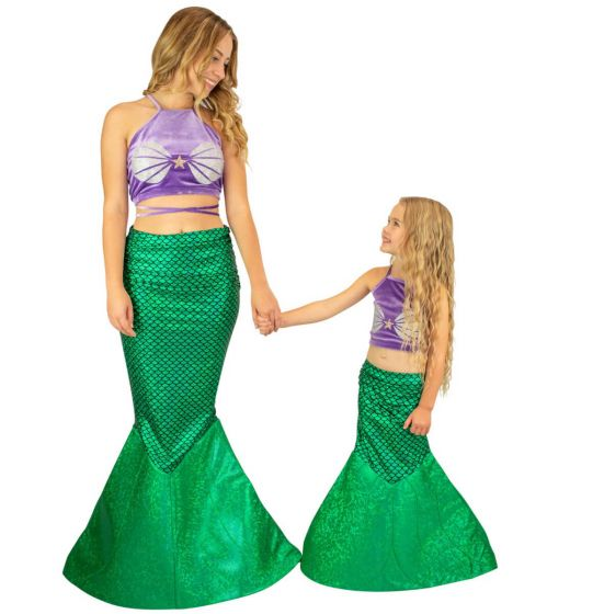 an older and younger girl wearing the green mermaid tail costume with a purple velvet top